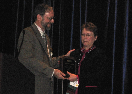 Dianne Haley receives a Leadership Award from Ed Wells