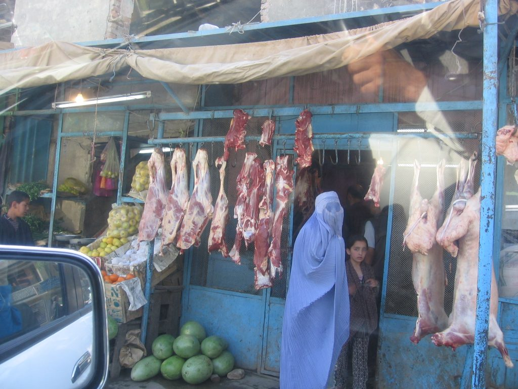 A woman buying meat in Afghanistan